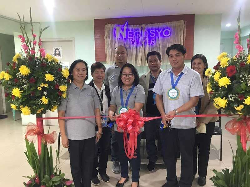 Department of Trade and Industry- Negros Occidental officials and personnel led by Provincial Director Lea Gonzales (center) and Silay City officials headed by Councilor Thomas Maynard Ledesma (right) during the opening of the Negosyo Center in the said city on Thursday, December 20. (Contributed photo)