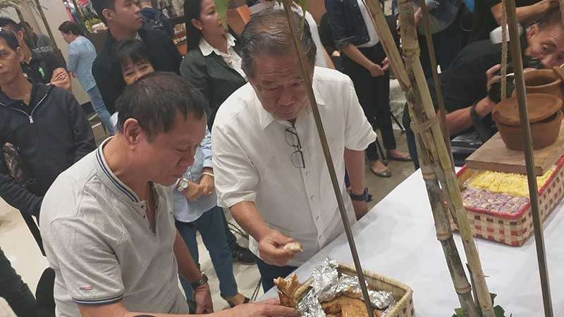 BACOLOD. Negros Occidental Governor Alfredo Marañon Jr. (right) with Provincial Agriculturist Japhet Masculino is having a taste of the food showcased during the second day of the