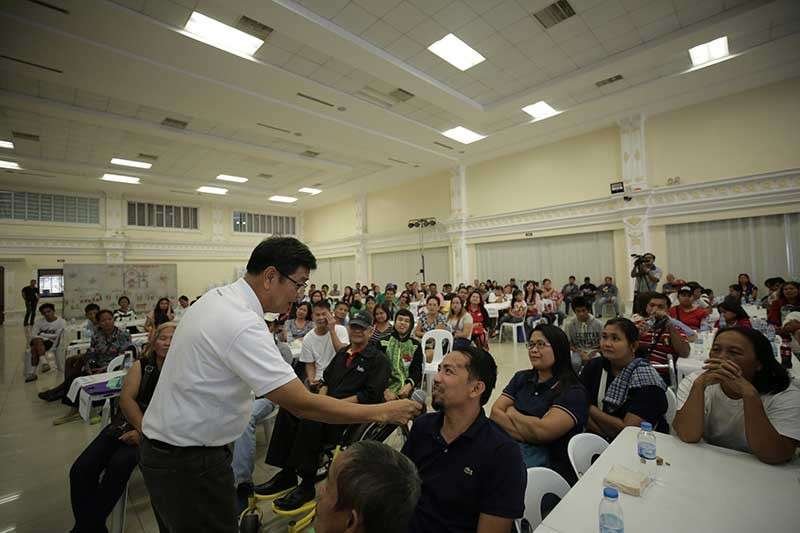 PAMPANGA. Mayor Edwin Santiago shares stories with some Fernandino persons with disabilities (PWDs) during the observance of International Day of PWDs in the city on December 18 at Heroes Hall. (Contributed photo)