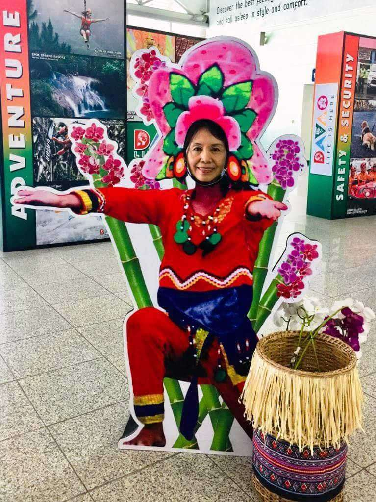 DAVAO. The author hams it up with a welcome poster upon arrival at the Davao airport. (Debb Bautista)