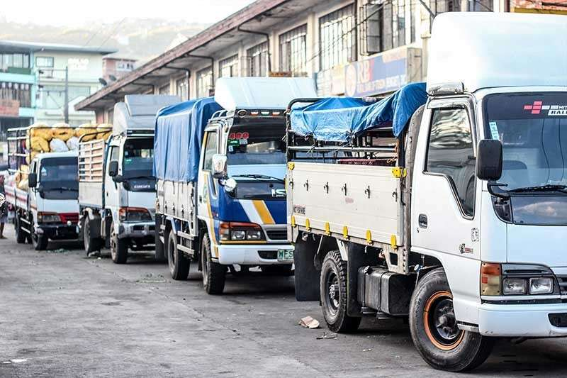 ECONOMIC BACKBONE. Trucks park near the wet market in KM 5 La Trinidad, Benguet while waiting to unload their vegetables. The vegetable industry remains the biggest economic backbone of La Trinidad with millions and millions paid in taxes from traders and farmers. (Jean Nicole Cortes)