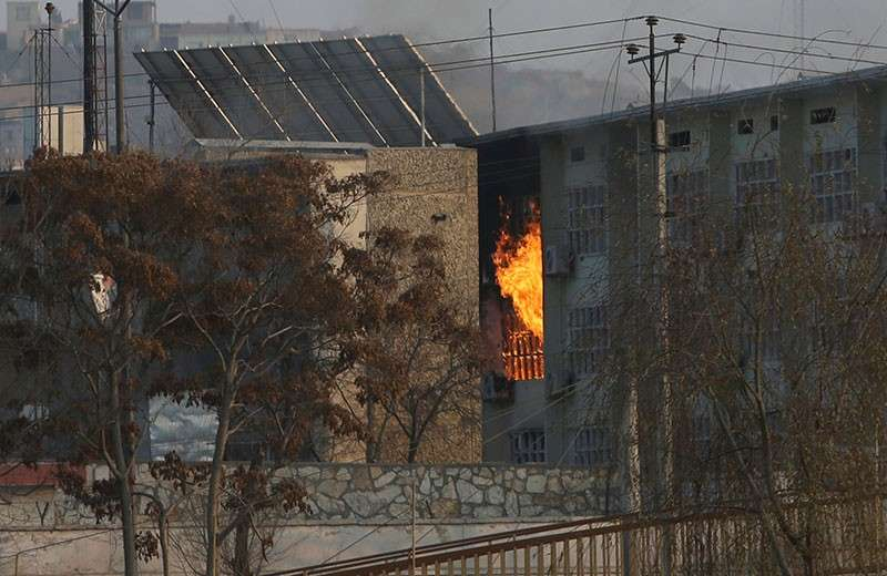 AFGHANISTAN. Flames rise from a government building after an explosion and attack by gunmen, in Kabul, Afghanistan, Monday, December 24, 2018. (AP Photo/Rahmat Gul)