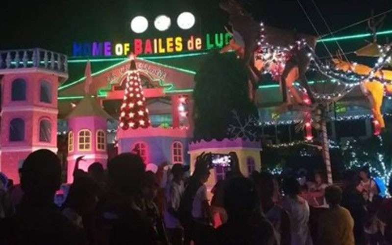 BACOLOD. Residents of La Castellana, Negros Occidental flock nightly to the town plaza which has been transformed into a wonderland of Disney characters fused with colorful lanterns to keep the Filipino Christmas tradition alive. (Photo by Erwin P. Nicavera)