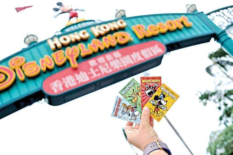 HONG KONG. The new park admission ticket designs featuring Mickey Minnie Donald and Pluto. (Jojie Alcantara)