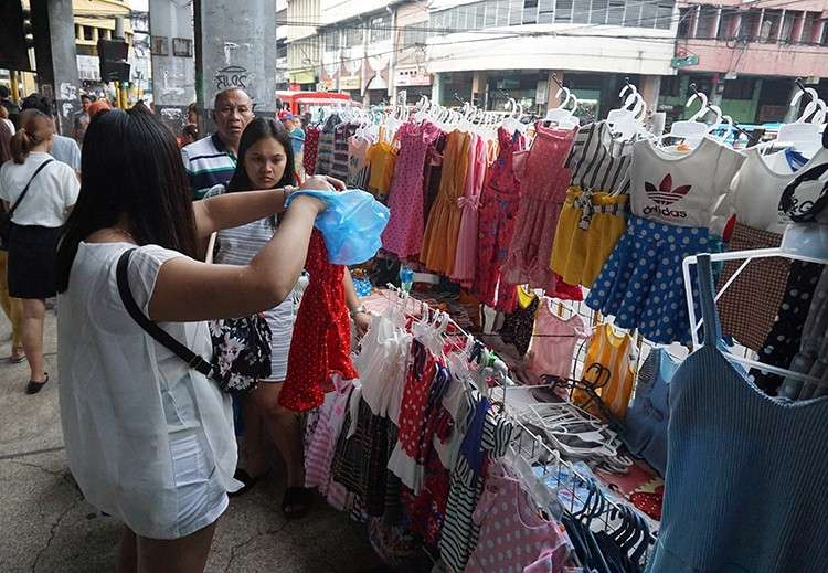 Street Wear. Clothes are sold at a sidewalk in downtown Cebu City. Instead of going for pricier items, consumers are choosing to buy cheaper goods. But that doesn't mean they won't get new outfits for the new year. (SunStar Foto / Alex Badayos)