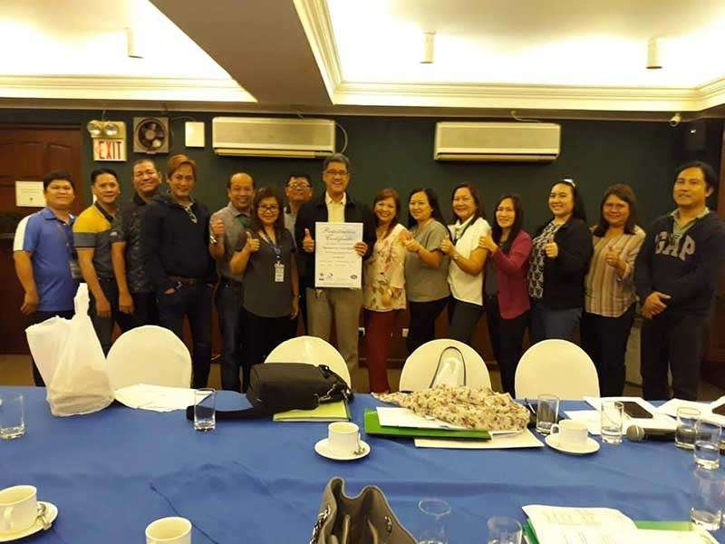 PAMPANGA. Mabalacat City Water District (MWCD) general manager Francis Dimaliwat together with other officer of MCWD holds a copy of the Registration Certificate from AJA registrars certifying that the MCWD is now ISO 9001: 2015 certified. The certificate was given during a recent ceremony. (Contributed Photo)
