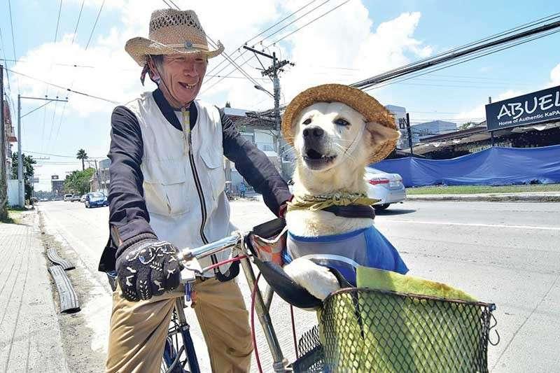 Seventy-four year old Japanese Fumio Tsunoda and his dog Whitney. (Contributed Photo)