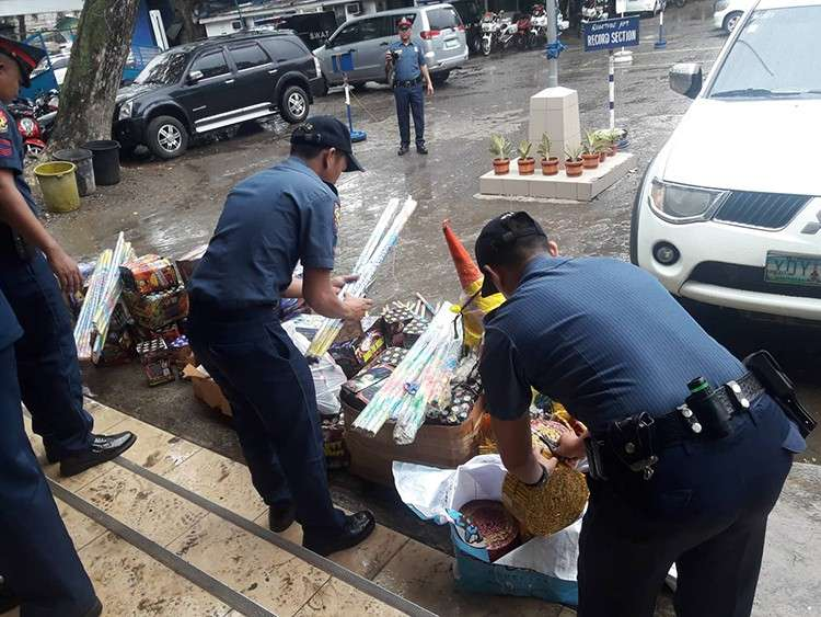 Not so lit. Operatives from the Cebu City Police Office douse close to P1 million worth of firecrackers with water so they could no longer be sold. Those were not among the firecrackers allowed to be sold in the Philippines. (SunStar Foto / Arnold Y. Bustamante)