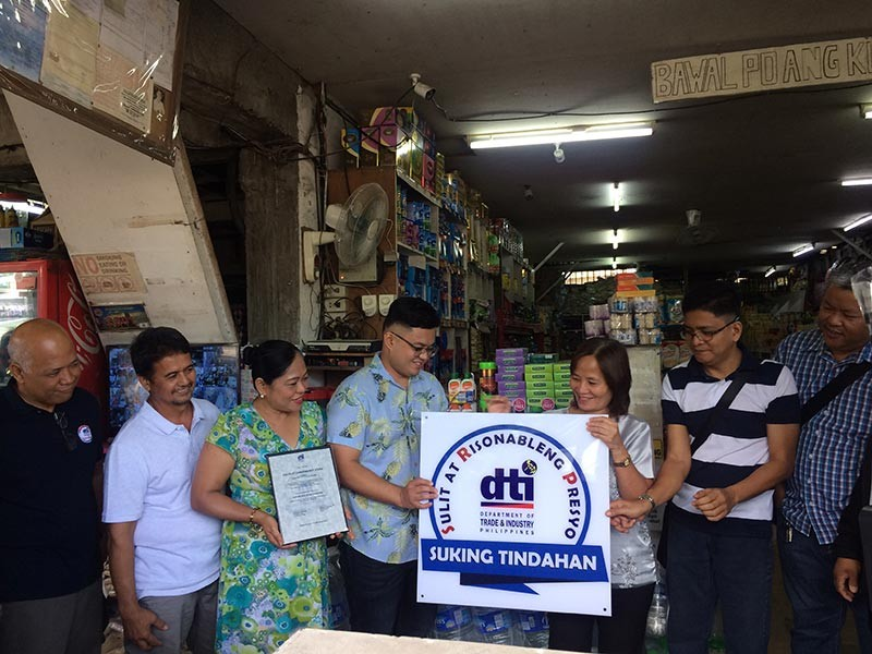 PAMPANGA. Department of Trade and Industry officer-in-charge Provincial Director Elenita Ordonio leads the conferment of the Suking Tindahan Seal to Calulut Convenience Store. The establishment, located in Barangay Calulut in the City of San Fernando, becomes the first recipient in the province of Pampanga. (Contributed photo)