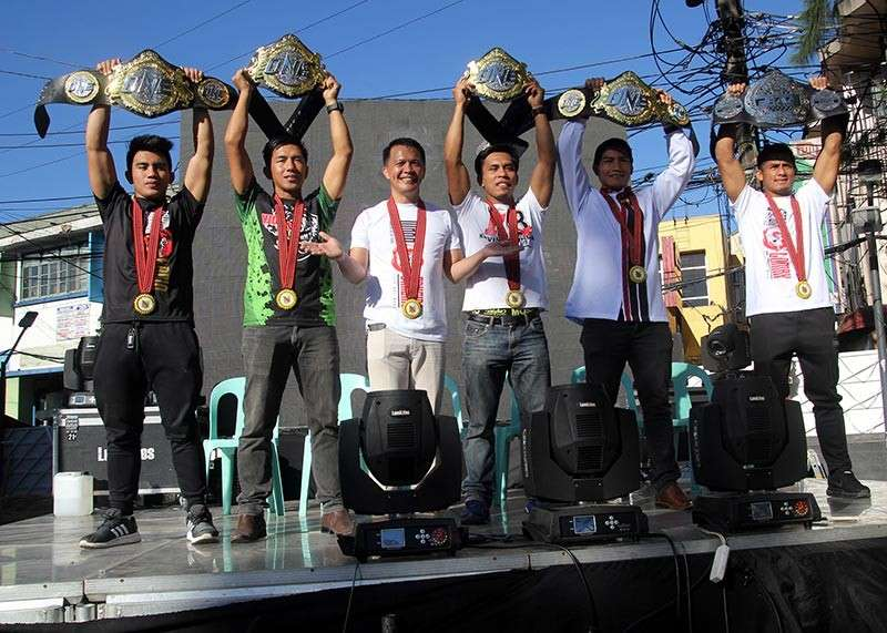 BAGUIO. Mark Sangiao presents to the public the five champions from Team Lakay during a thanks giving parade for the group. (Roderick Osis)
