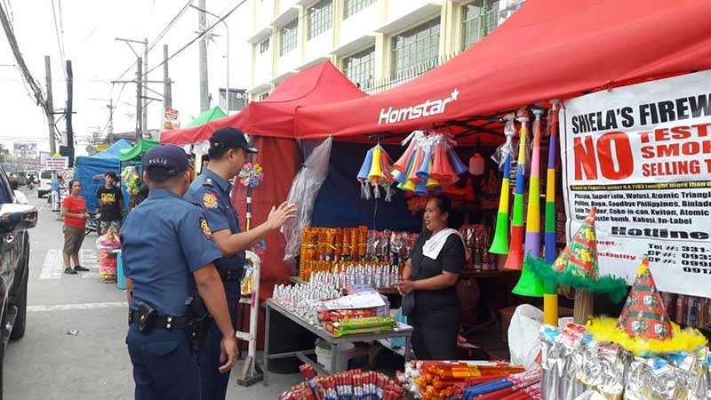 PAMPANGA. Senior Superintendent Oscar Villasis, Mabalacat City police chief, inspects firecracker stores in Barangay Dau following the designation of pyrotechnic zones in Central Luzon. (Contributed photo)