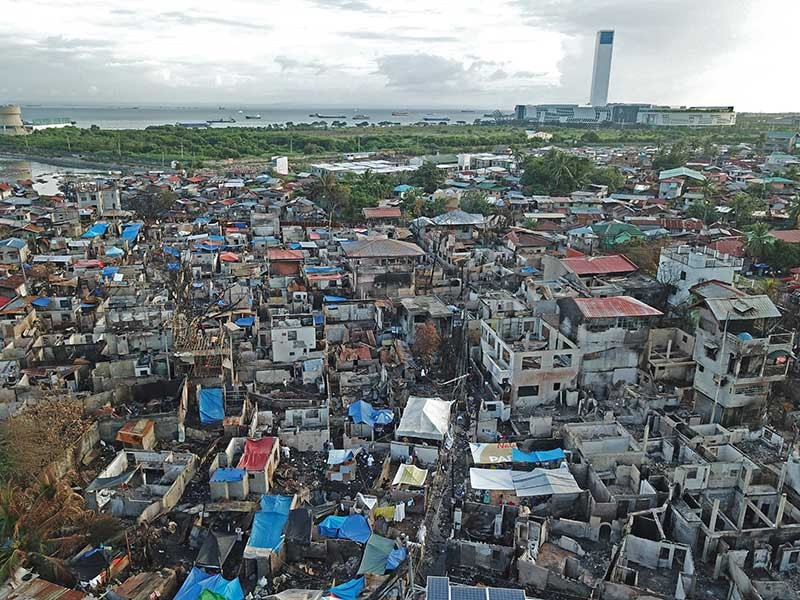 DISASTER SO COSTLY. An aerial view of the aftermath of the Barangay Duljo-Fatima fire on Christmas dawn. The city's disaster agency says fire tops the list of disasters that hit the city, year in and year out. (SunStar photo/Allan Cuizon)