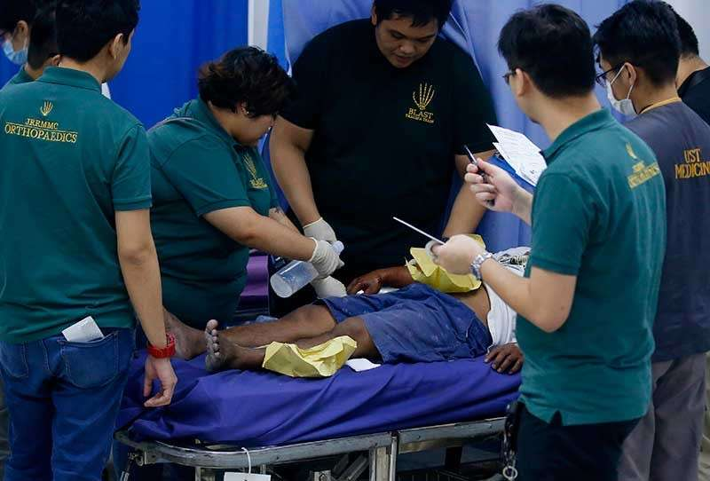 MANILA. A reveler is treated for injuries following the raucous New Year celebration Tuesday, Jan. 1, 2019. (AP)