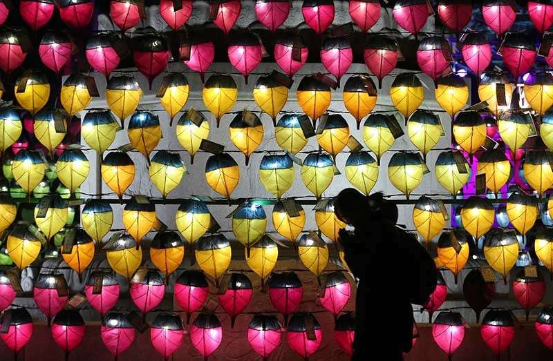 SOUTH KOREA. A woman prays in front of a wall of lanterns to celebrate the New Year at the Jogyesa Buddhist temple in Seoul, South Korea, Monday, Dec. 31, 2018. (AP)