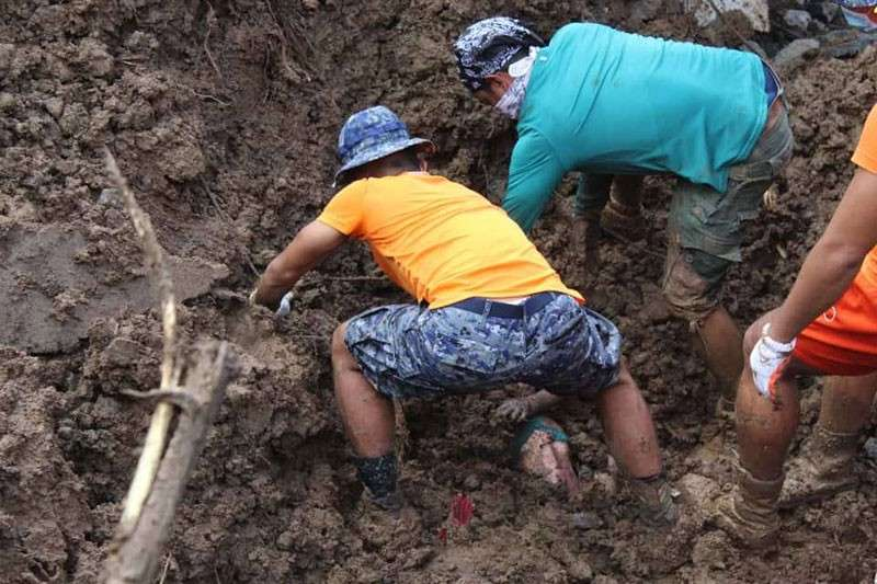 BICOL. Search and retrieval operations in landslide-hit areas in Sagnay, Camarines Sur. (Photo from Coast Guard Bicol)