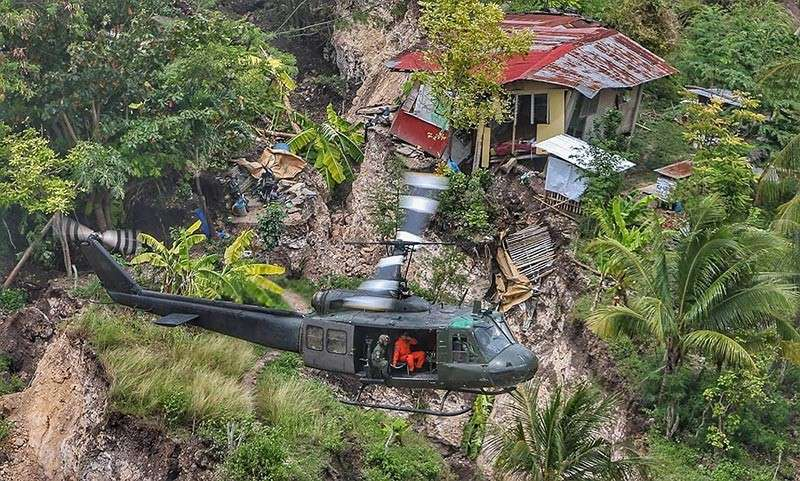 AERIAL SURVEY. A helicopter conducts an aerial survey on the extent of the Naga landslide on Sept. 20, 2018. (SunStar photo / Alex Badayos)