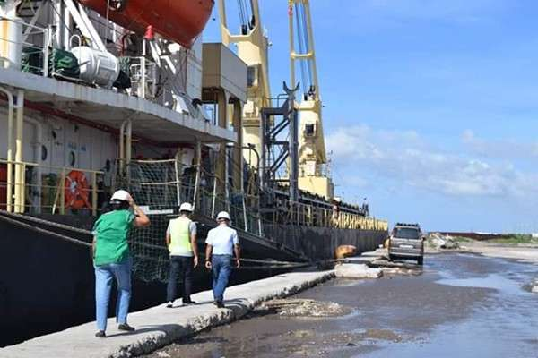 NEGROS. National Food Authority- Negros Occidental personnel inspect MV Tan BINH 79 docked at Bacolod Real Estate Development Corporation Port in Bacolod City on Tuesday, January 1. The vessel carries 160,000 bags of rice from Vietnam, the third import allocation for Negros Occidental for 2018. (Contributed photo)