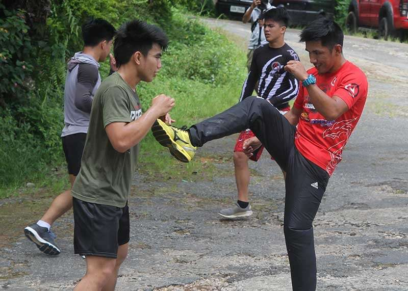 BAGUIO. Flyweight world champion Geje Eustaquio and strawweight champion Joshua Pacio train at the Lourdes Grotto as they gear up for their first title defense. Pacio will headline One Championship event in Jakarta, Indonesia on January 19 while Eustaquio takes on Moraes on the 25th at the Mall Of Asia Arena. (Photo by Roderick Osis)