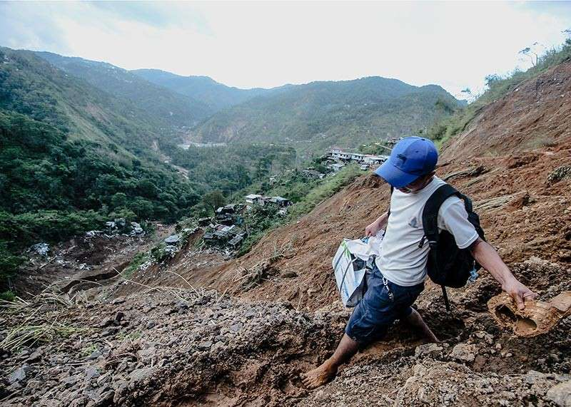 A resident of Barangay Ucab in Itogon town flee from safety during the landslide caused by Typhoon Ompong in 2018. Itogon Municipal Council sought the help of the Regional Development Council for a thorough geological assessment and evaluation of the area. (Photo by Jean Nicole Cortes)
