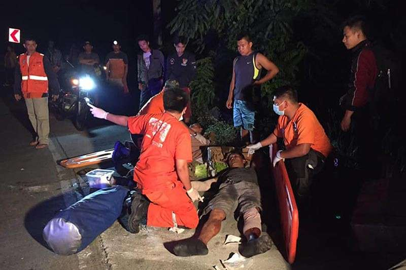 An emergency response team attends to an injured passenger involved in a vehicular accident along Taloy Sur, Marcos Highway on January 3. Police said road crash deaths increased to 120 percent in 2018. (Contributed photo)