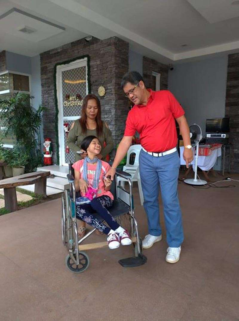 Mabalacat City Water District general manager Francis Dimaliwat shows a wheelchair donated few years ago by the Freemasonry to a girl suffering from cerebral palsy. (Contributed photo)