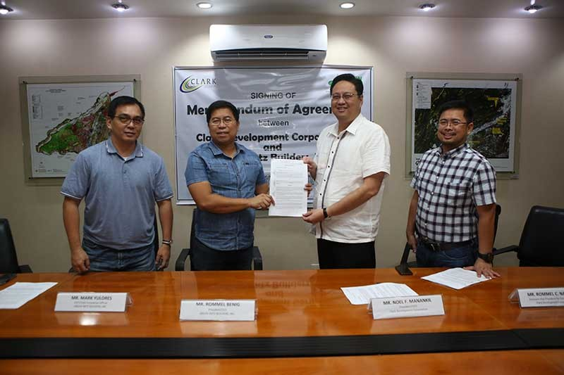 PAMPANGA. Clark Development Corporation (CDC) President and CEO Noel Manankil (2nd right) and Green Antz Builders, Inc. President and CEO Rommel Benig (2nd left) show the Memorandum of Agreement after signing into partnership to explore ways and means in promoting environmentally-friendly practices. Also, in the photo are CDC Assistant Vice President for External Affairs Rommel Narciso (extreme right) and Green Antz Builders, Inc. Executive Vice President and Chief Innovative Officer Mark Yulores who witnessed the said signing. (Contributed Photo)