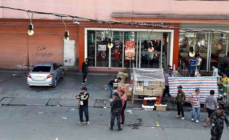 COTABATO CITY. National police investigators examine the site at the South Seas Mall following an explosion on New Year's Eve in Cotabato City Monday, December 31, 2018. (AP)