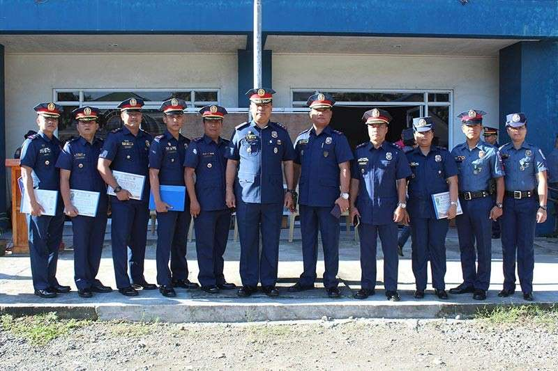 BACOLOD. The awardees of the Bacolod City Police Office (BCPO, along with Senior Superintendent Francisco Ebreo (center), acting BCPO director, in rites held at the city police headquarters Monday, January 7. (Contributed photo)