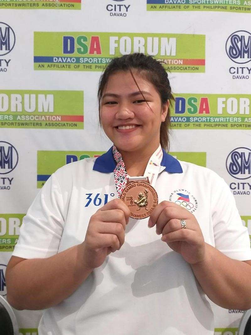 DAVAO. Sydney Sy Tancontian beams as she poses showing her World Sambo Championships bronze medal after guesting at the Davao Sportswriters Association (DSA) Forum at The Annex of SM City Davao yesterday. (Marianne L. Saberon-Abalayan)