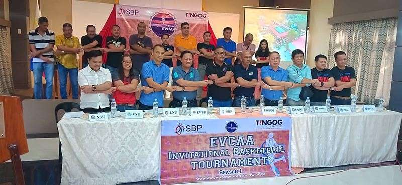 TACLOBAN. University presidents and representatives from eight state university and colleges in Eastern Visayas lock arms to signify their support and commitment after the signing of the memorandum of agreement of the first inter-collegiate basketball tournament launched by the Eastern Visayas Collegiate Athletic Association on January 11, 2019 in Tacloban City. (Contributed photo)