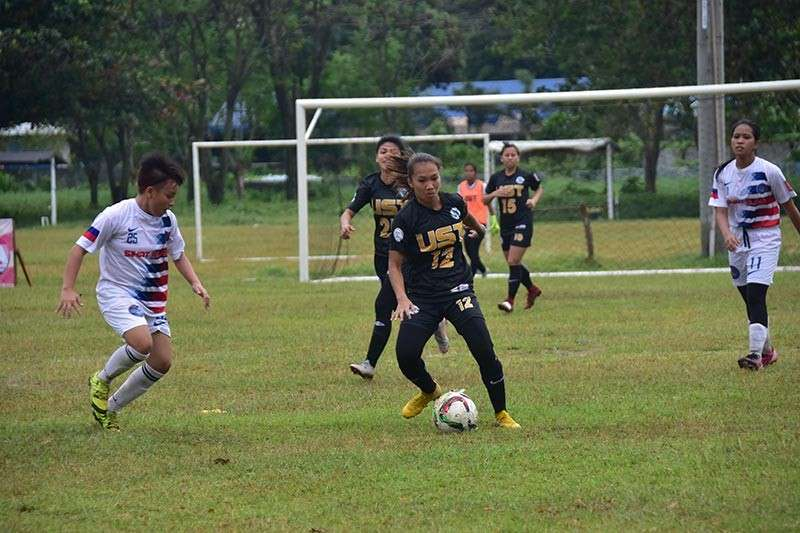 DAVAO. Hazel Lustan, no. 12, of the University of Santo Tomas (UST) Team A takes possession of the ball during a game against Sikat Alab Football Club of Davao City in the 4th Pinay in Action (PIA) Cup football tournament at Tionko field Friday, January 11, 2019. She netted five goals for the defending champion team's opening win. (Photo by Macky Lim)