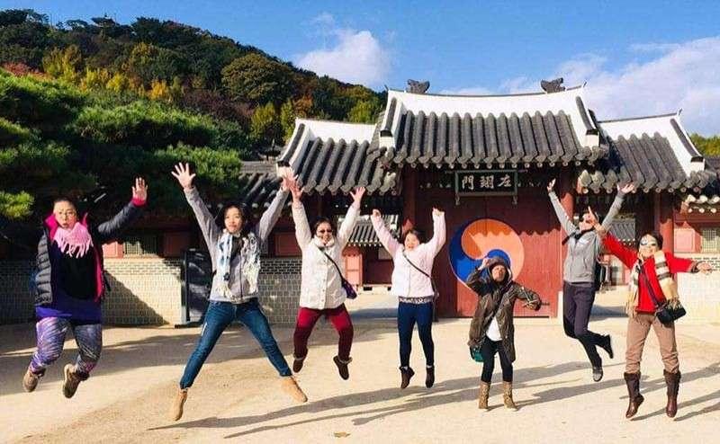 SOUTH KOREA. Jumping with delight on Huaseong Haenggung Palace are L-R: Maeve, Jil, Benita, Cicilia, Mary Ann, Vina, and the author. (Debb Bautista)