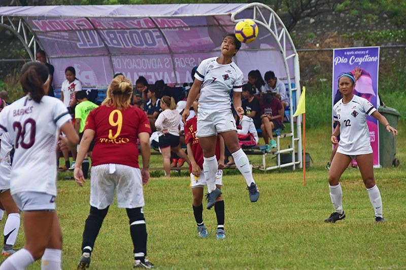DAVAO. A University of the Philippines Women's Football Team (UPWFT)-Y player hits a header during a 4th Pinay in Action (PIA) Cup game against Tiago Football Club of Dapitan at Tionko field in Davao City Saturday, January 12, 2019. (Macky Lim)