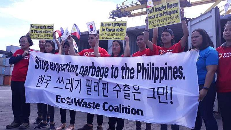 """TAGOLOAN. Waste and pollution watch group, EcoWaste Coalition, applauds the departure from the Philippines of 51 containers of illegal garbage exports from South Korea, extolling the move as a """"triumph for environmental justice, morality and the rule of law."""" (Photo from EcoWaste Coalition Facebook)"""