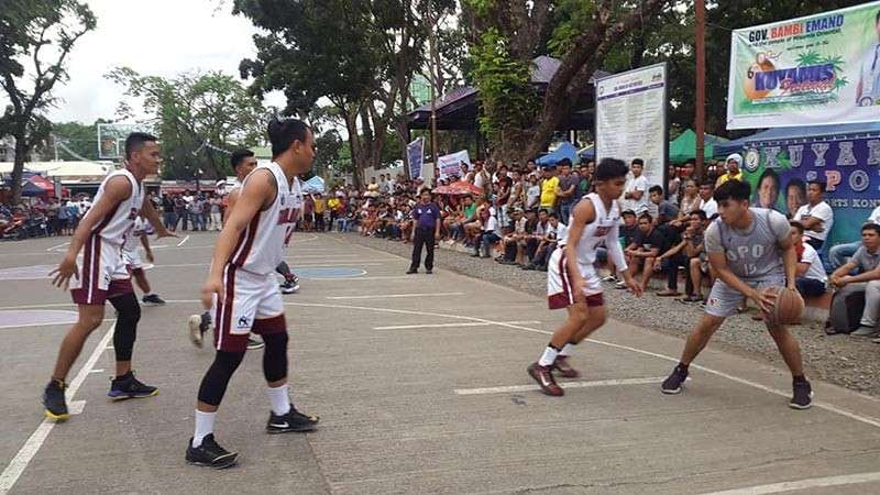CAGAYAN DE ORO. The Opol Dolphins managed to break Tagoloan's defense in the final half en route to a come-from-behind 88-72 win for the 25-under crown of the Kuyamis hoopfest on Thursday, January 10, at the Capitol grounds in Cagayan de Oro City. (Lynde Salgados)