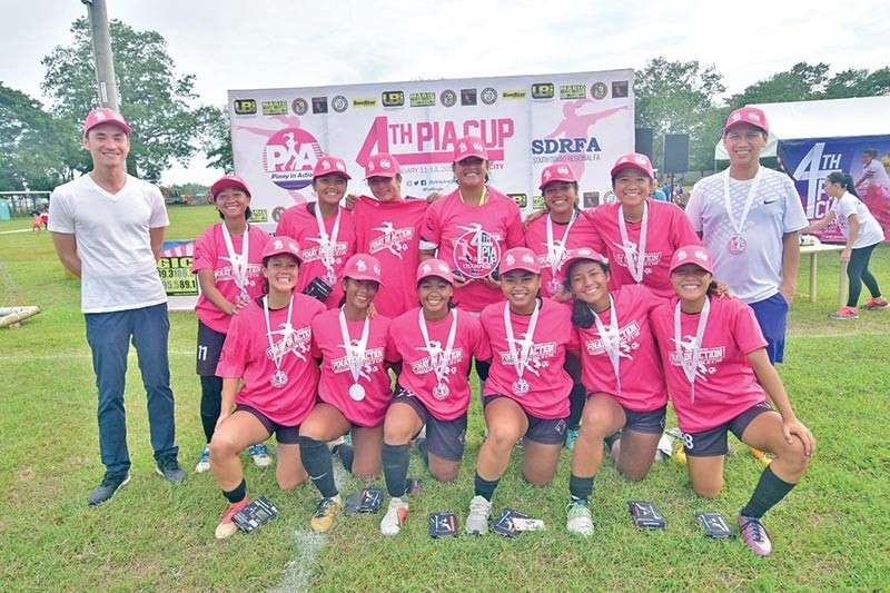 DAVAO. Members of the University of the Philippines Women's Football Team (UPWFT)-X celebrate their championship victory in the 4th Pinay in Action (PIA) Cup. Also in photo are Anton Lopez of Ulticon Builders, Incorporated and South Davao Region Football Association president Henry Sabate. (Macky Lim)