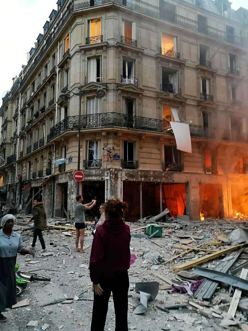 FRANCE. The scene of a gas leak explosion in Paris, France, Saturday, Jan. 12, 2019. A powerful explosion and fire apparently caused by a gas leak at a Paris bakery Saturday injuring more than 40 people blasted out windows and overturned cars, French authorities said. (Matthieu Croissandeau via AP)