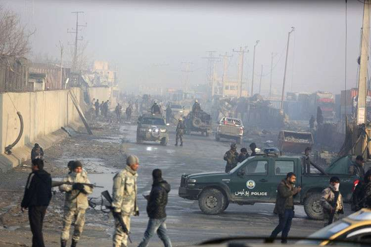 AFGHANISTAN. Afghan security forces gather at the site a day after an attack in Kabul, Afghanistan, Tuesday, January 15,  2019. A Taliban suicide bomber detonated an explosive-laden vehicle in the capital Kabul on Monday evening, according to officials. (AP)