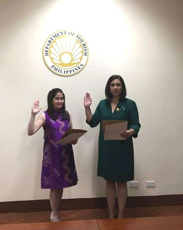 DAVAO. The newly-appointed regional director of Department of Tourism in Davao Tanya Rabat-Tan takes her oath which was administered by Tourism Secretary Bernadette Romulo-Puyat. (Contributed Photo By Albert Egot)