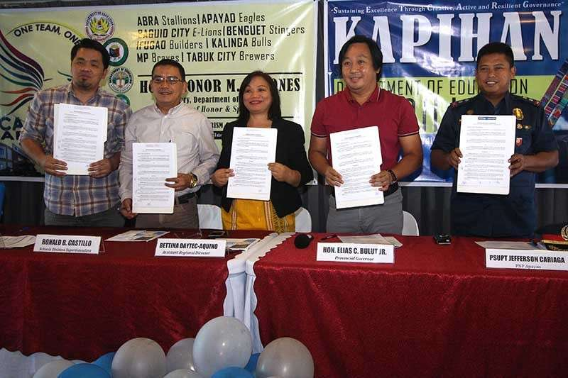 """BAGUIO. Apayao Governor Elias Bulut Jr. (second from right) together with Department of Education (DepEd) represented by deputy regional sports coordinator Georaloy Palao-ay, Apayao schools division superintendent Ronald Castillo, DepEd assistant regional director Bettina Daytec-Aquino and Apayao deputy provincial director Superintendent Jefferson Cariaga sign the memorandum of agreement for the hosting of Caraa meet slated on February 27 to March 3 in Luna with a theme """"One team, One vision."""" (Photo by Jean Nicole Cortes)"""