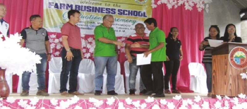 FARM OF LIFE. Farmers receive their certificates from the Department of Agrarian Reform Cebu officials after completing their training on improving their business acumen and farm production. (Contributed Photos)