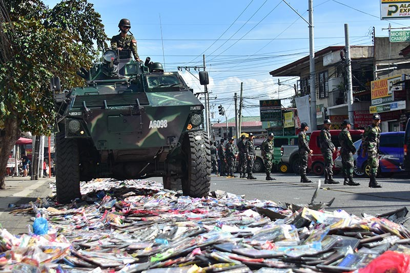 DAVAO. The Optical Media Board (OMB), together with local authorities, destroyed Thursday, January 17, a total of 440 sacks of pirated DVDs and CDs worth P63 million. (Macky Lim)