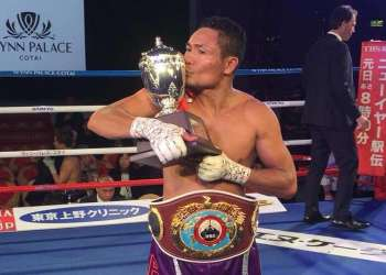 MACAU. Donnie Nietes kisses the trophy awarded to him after beating Japanese star Kazuto Ioka in their World Boxing Organization super flyweight title fight in Macau on New Year's Eve. (Carlos Costa)