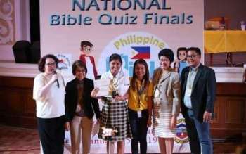 PANGASINAN. Jireh Ceralde (third from left) receives her award as first placer in the first ever Bible quiz national finals held in Pangasinan. (Photo courtesy of Provincial Government of Pangasinan's official Facebook page)