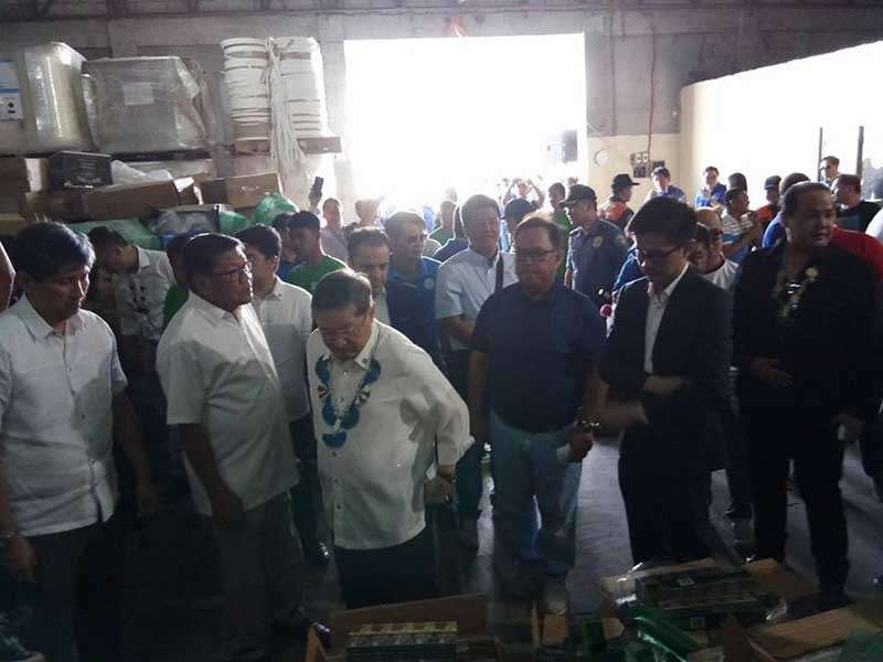 PAMPANGA. Finance Secretary Carlos Dominguez III leads the inspection of illegal cigarettes all set for disposal at the DaGiMa Waste Management Facility in Barangay Mitla in Porac town. Joining him are BIR Commissioner Caesar Dulay, Deputy Commissioner Arnel Guballa and Vice-Gov. Dennis Pineda. (Ian Ocampo Flora)