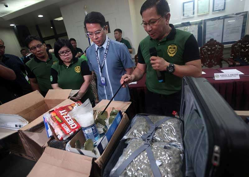 PAMPANGA. PDEA director general Aaron Aquino examines various illegal drugs seized at Clark Freeport the other day. (Contributed Photo)