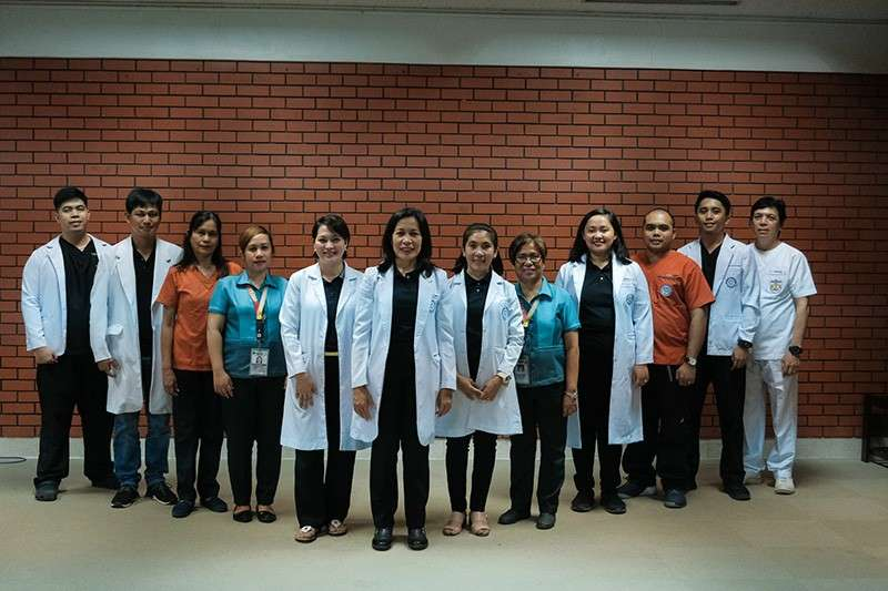 DAVAO. The pioneering graduates, Dr. Andrew Louis Lamela (leftmost) and Dr. Gino Arvin Santos (second from right) with the dental plantilla and staff of Southern Philippines Medical Center-Department of Dental Medicine, Dr. Mariano Wales, Marylou Geralla, Jennifer Yucosing, Dr. Annalyn Lim, Dr. Haidee Digma, Dr. Ma. Trinidad Maganto, Eden Cayao, Dr. Rosana Ang-Millan, Rainier Degollacion, and Paul Mendoza. (Stella A. Estremera)