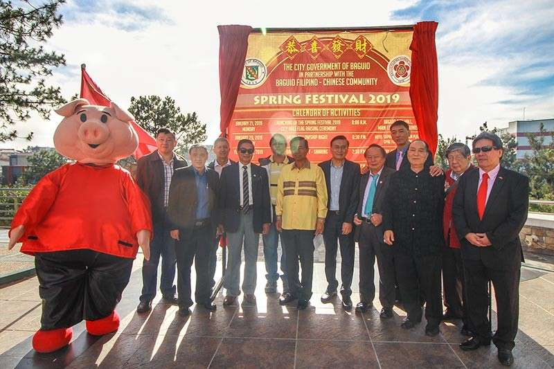 BAGUIO. Baguio City Officials and members of the Baguio Filipino-Chinese Community launch the Spring Festival on Monday during the flag raising ceremony at the Baguio City Hall. (Jean Nicole Cortes)