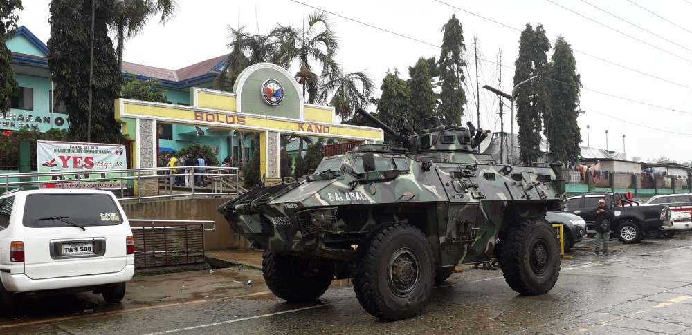 LANAO. Tanks line up in front of the Saguiran Municipal Hall in Lanao del Sur to increase security for the Bangsamoro Organic Law (BOL) plebiscite Monday, January 21. (Riz Sunio)