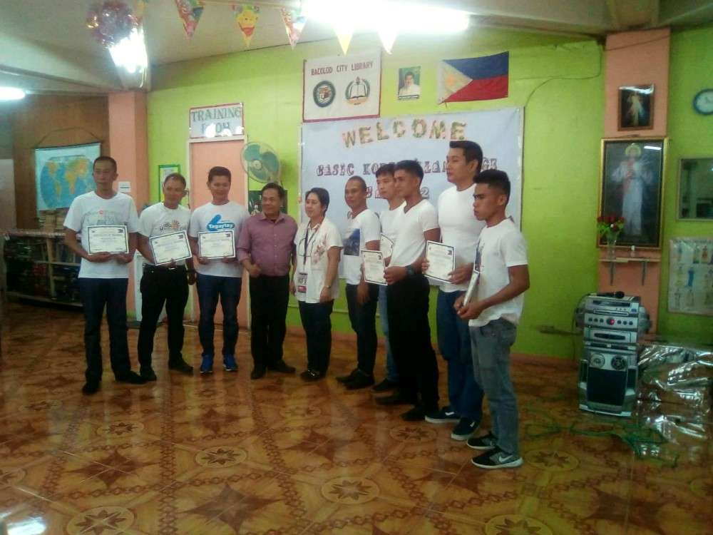 BACOLOD. Godofredo Sumicad, Reynold Aquino, Erol Nales, Korean language instructor Rodney Bomban, Bacolod City librarian Greta Memoria, Korean language instructor Francisco Corpuz, Arjay Cuenca, Johnester Espinosa, Vincent Englis and Leovin Dela Serna during the rites held recently at the city public library. (Contributed photo)